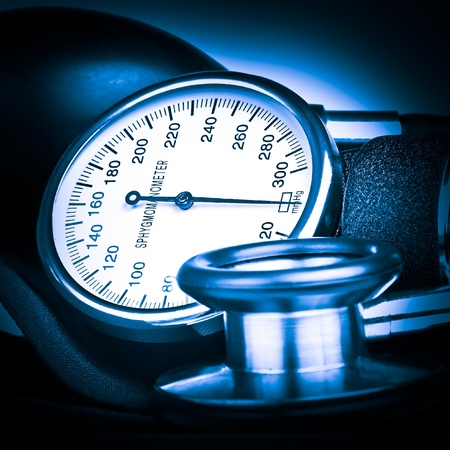 sphygmomanometer: Blue toned sphygmomanometer and stethoscope kit used to measure blood pressure Stock Photo