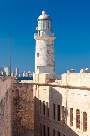 The lighthouse of El Morro in Havana with a view of the city in the background photo