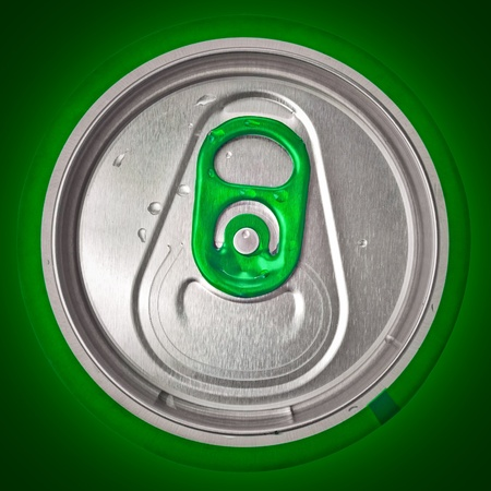 Top view of a beer or soft drink can on a green background photo