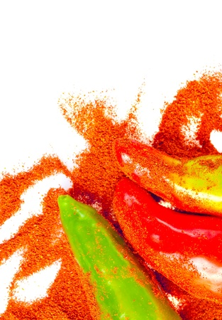 curry powder: Powdered spices and red and green peppers isolated on a white background Stock Photo