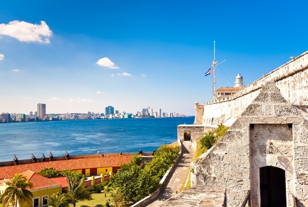 The castle and lighthouse of El Morro in Havana with a view of the city in the background