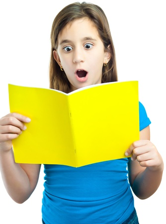 fear child: Beautiful hispanic girl reading a book with a surprised expression isolated on white