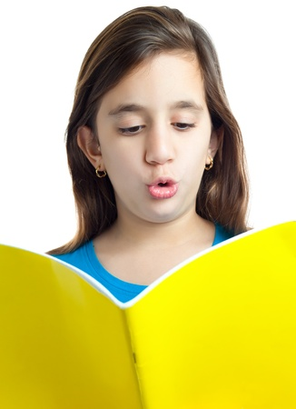 Beautiful hispanic girl reading a book isolated on white photo