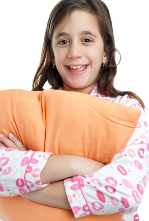 sleepover: Beautiful hispanic girl wearing pajamas and holding a pillow isolated on white