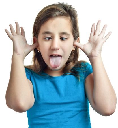 mockery: Small hispanic girl making a funny face isolated on white