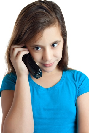 latina teen: Beautiful small hispanic girl talking on the phone isolated on white Stock Photo