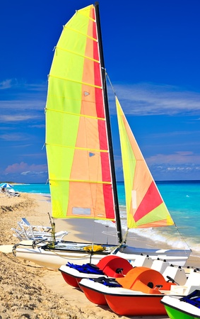Catamaran and paddle boats on the beautiful cuban beach of Varadero photo