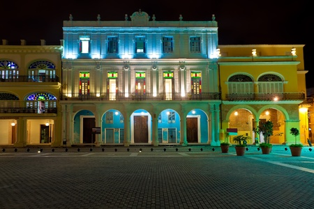 cobbled: Restored historical colonial buildings in Old Havana illuminated at night Stock Photo