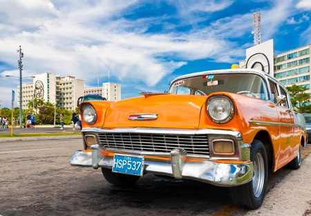 havana: Classic Chevrolet parked in the Revolution Square  in Havana