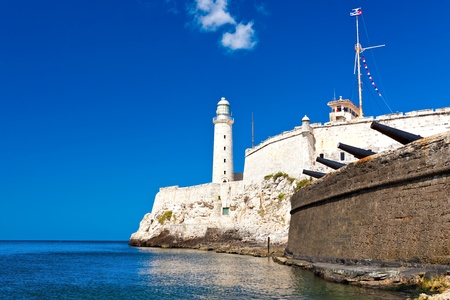 The famous castle and lighthouse of El Morro  in the bay of Havana photo