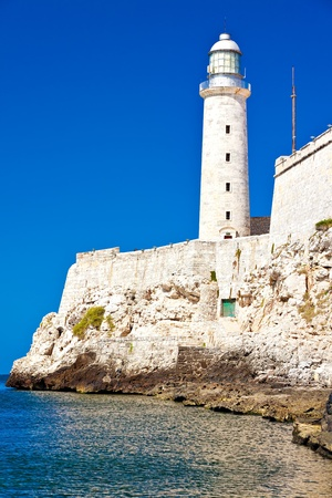 capital building: Vertical shot of the famous castle and lighthouse of El Morro, a symbol of Havana