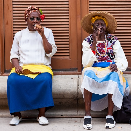HAVANA-FEBRUARY 26 Women in typical clothing February 26,2012 in Havana With the growth of foreign tourism people like these,working for tips,make their living posing as traditional cuban characters