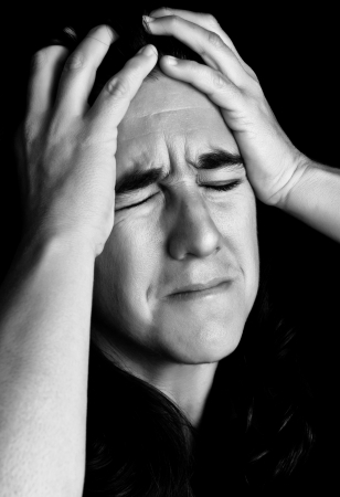 emotional grief: Black and white portrait of very stressed woman with a desperate or crazy expression