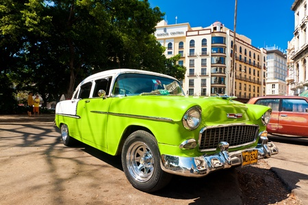 chevrolet: Classic Chevrolet parked next to the Central Park  in Havana Editorial