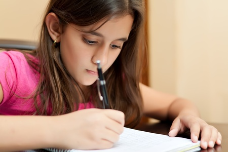 Beautiful latin girl working on her school homework photo