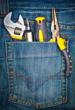 Several tools on a denim jeans pocket photo