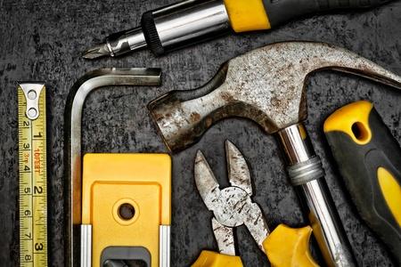 Set of tools on a textured metallic background photo