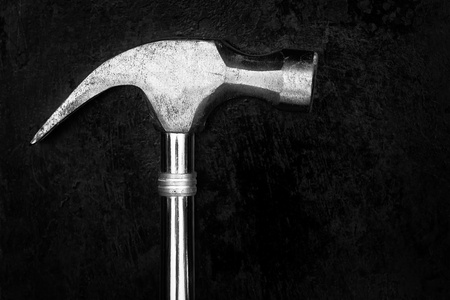 Hammer on a dark grunge metallic background with space for text Stock Photo - 12902841
