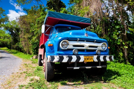PINAR DEL RIO,CUBA-APRIL 7 Old Ford truck in a rural road April 7,2012 in Pinar del Rio Before a new law issued on October 2011,cubans could only trade vehicles that were on the road before 1959