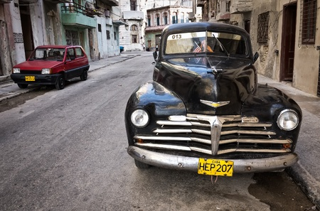 chevrolet: Classic Chevrolet in a shabby neighborhood in Old Havana
