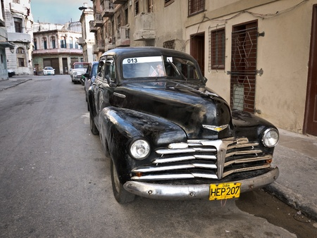 car grill:  Classic Chevrolet in a shabby neighborhood in Old Havana  Editorial