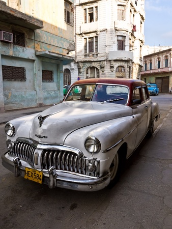 oldtimer: Classic DeSoto in a shabby neighborhood in Old Havana