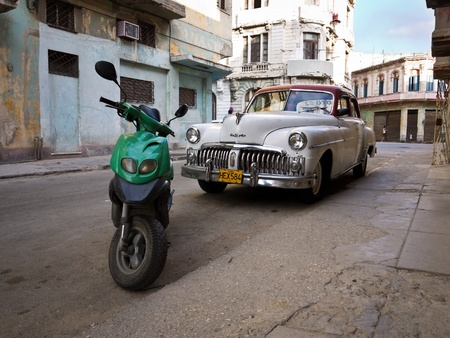 Classic DeSoto in a shabby neighborhood in Old Havana