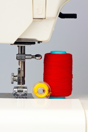 Sewing machine and reels with colorful  thread photo