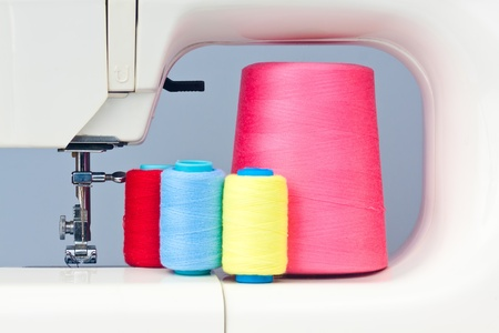 Sewing machine and colorful thread bobbins photo