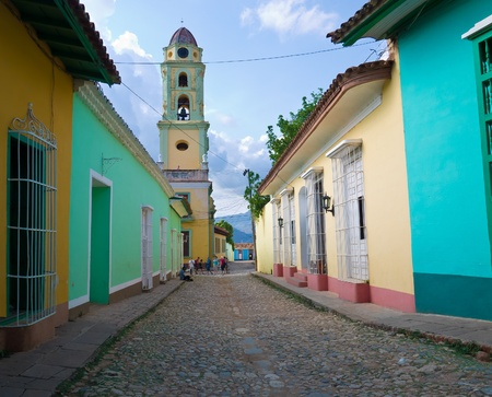 colonial: Old church sidelined by colorful houses in the colonial town of Trinidad in Cuba, a famous touristic landmark on the caribbean island