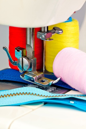 accesories: Macro image of a sewing machine , reels with thread and clothing accesories