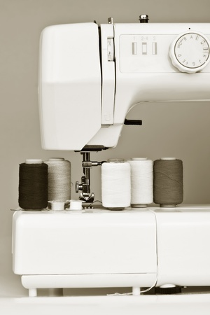 Monochromatic image of a sewing machine and reels photo