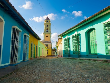 latin  america: Colorful traditional houses and old church in the colonial town of Trinidad in Cuba