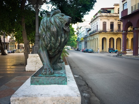 Bronze lion in the boulevard of El Prado in Havana, these statues are a symbol of the cuban capital photo