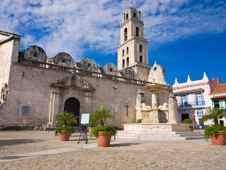 importance: The San Francisco Square and the church with the same name in Old Havana , a touristic landmark famous for its traditional architecture and its cultural importance in Old Havana Stock Photo