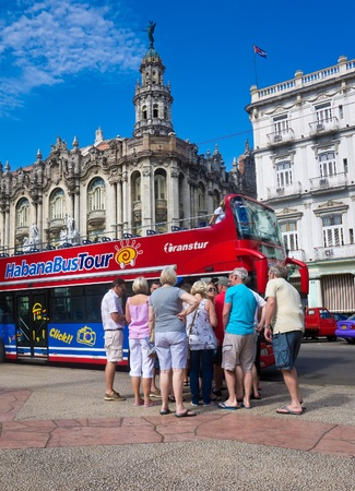 HAVANA-MAY 4 Tourists boarding a sightseeing bus May 4,2012 in Havana With its distinct culture,Havana is the destination of the majority of the approximately 2 million tourists visiting Cuba yearly