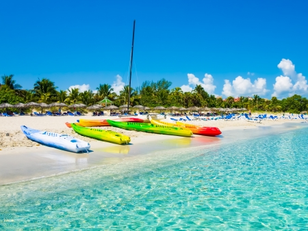 Kayaks and sailing boats on the beautiful beach of Varadero in Cuba  image taken from the sea  photo