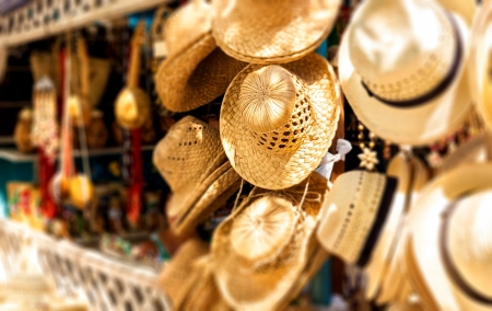 varadero: Street market selling hats and souvenirs in the touristic town of Varadero in Cuba photographed with a shallow depth of field