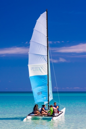 VARADERO,CUBA-MAY 27 Young tourists sailing in a catamaran May 27,2012 in Varadero With over a million visitors per year,Varadero is the main destination for the growing cuban tourism industry