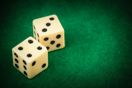 Two dice on a green gaming table with space for text Stock Photo - 13971813