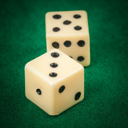 probability: Close up of two dice on a green gaming table Stock Photo