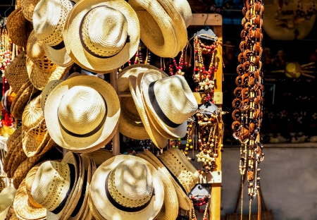 Market stall selling hats and souvenirs in the touristic town of Varadero in Cuba photo