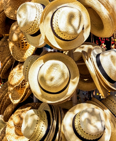 Handmade hats for sale on a touristic market in the beach of Varadero in Cuba photo