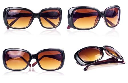 Set of modern sunglasses on a white background photo