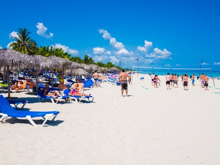 bather: Group of young tourists enjoying the beach of Varadero in Cuba