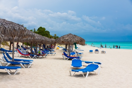bather: Group of  tourists relaxing at the beach in Cuba