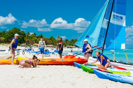 Tourists getting ready to go sailing in a beach in Cuba