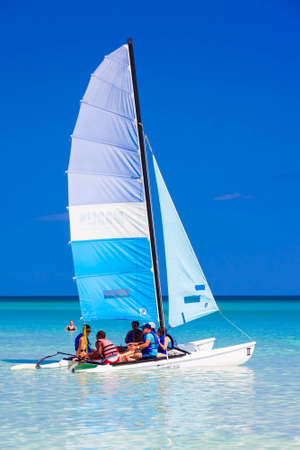 caribbean beach: Young tourists sailing in a catamaran in the cuban beach of Varadero