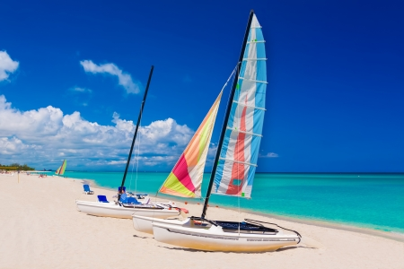 Colorful sailing boats on the  beach of Varadero in Cuba on a beautiful  summer day photo