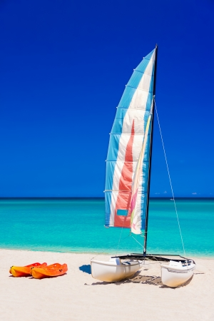 Colorful sailing boats on the  beach of Varadero in Cuba on a beautiful  summer day  vertical format without people  photo